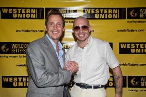 Western Union executive Mariano Dall'Orso and recording artist Pitbull at the Western Union World of Betters event in Miami (Photo: Business Wire)